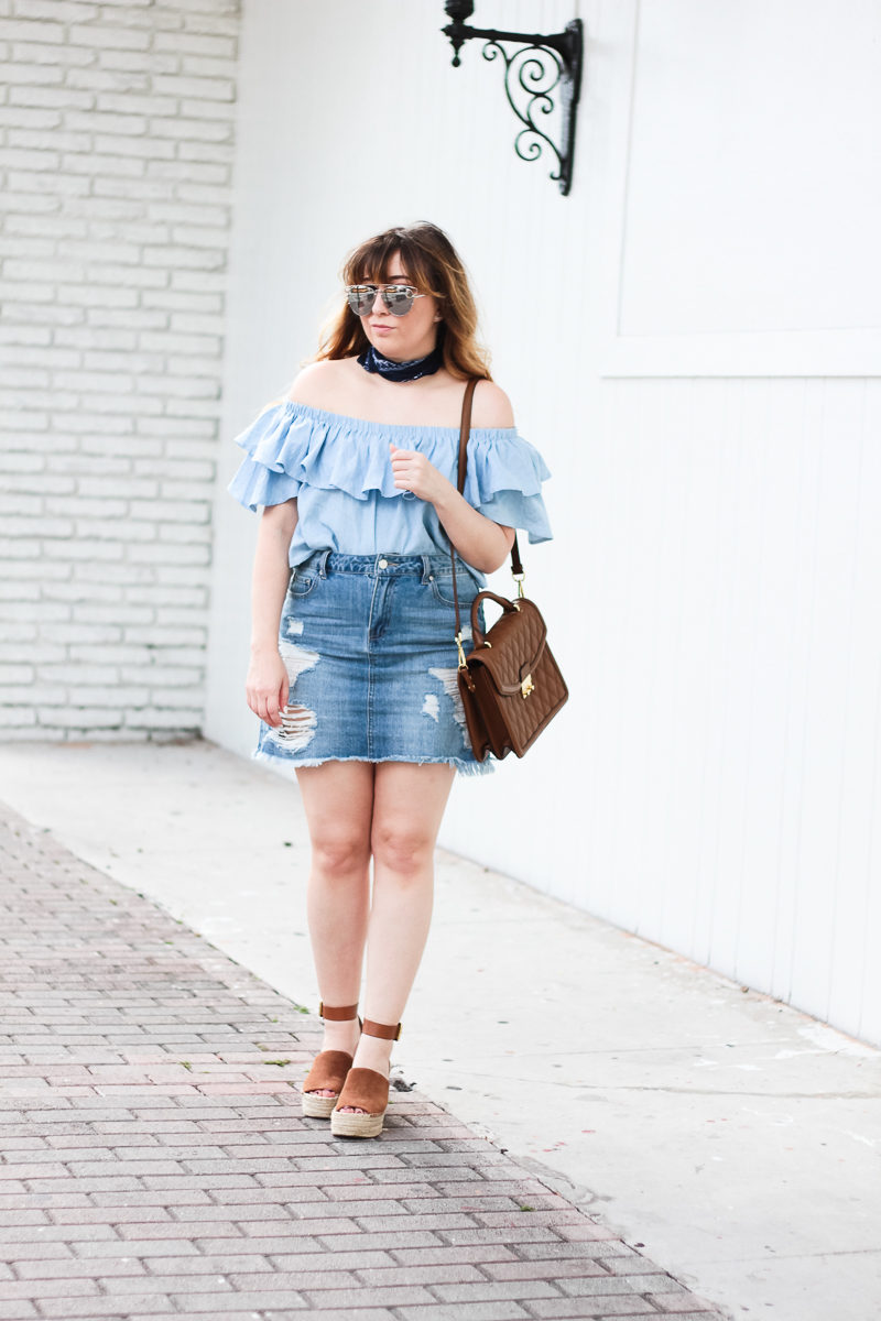 Miami fashion blogger Stephanie Pernas wearing a chambray off the shoulder top with a jean skirt for a casual spring outfit idea