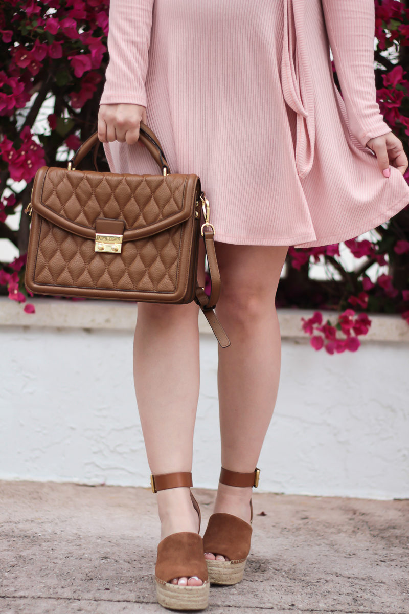 Miami fashion blogger Stephanie Pernas wearing Marc Fisher Adalyn wedges with a pink dress