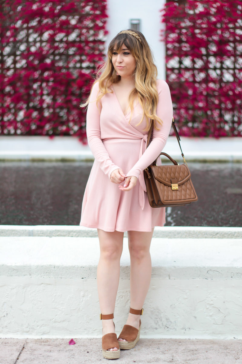 Miami fashion blogger Stephanie Pernas of A Sparkle Factor wearing a pink knit wrapdress for spring