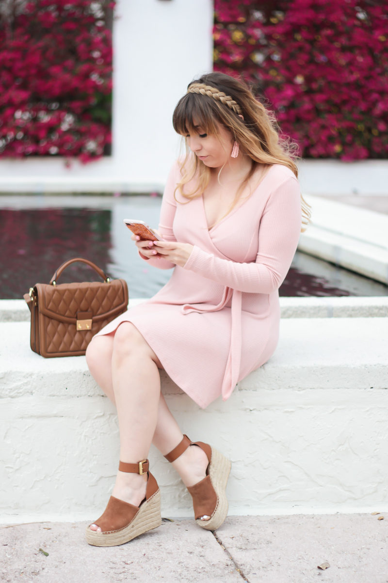 Miami fashion blogger Stephanie Pernas wearing a pink spring dress and wedges