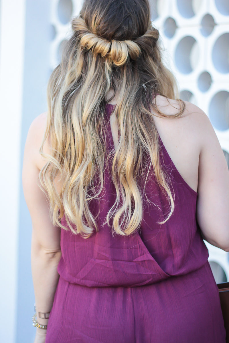 Miami fashion blogger Stephanie Pernas styles her hair in a twisted hair do