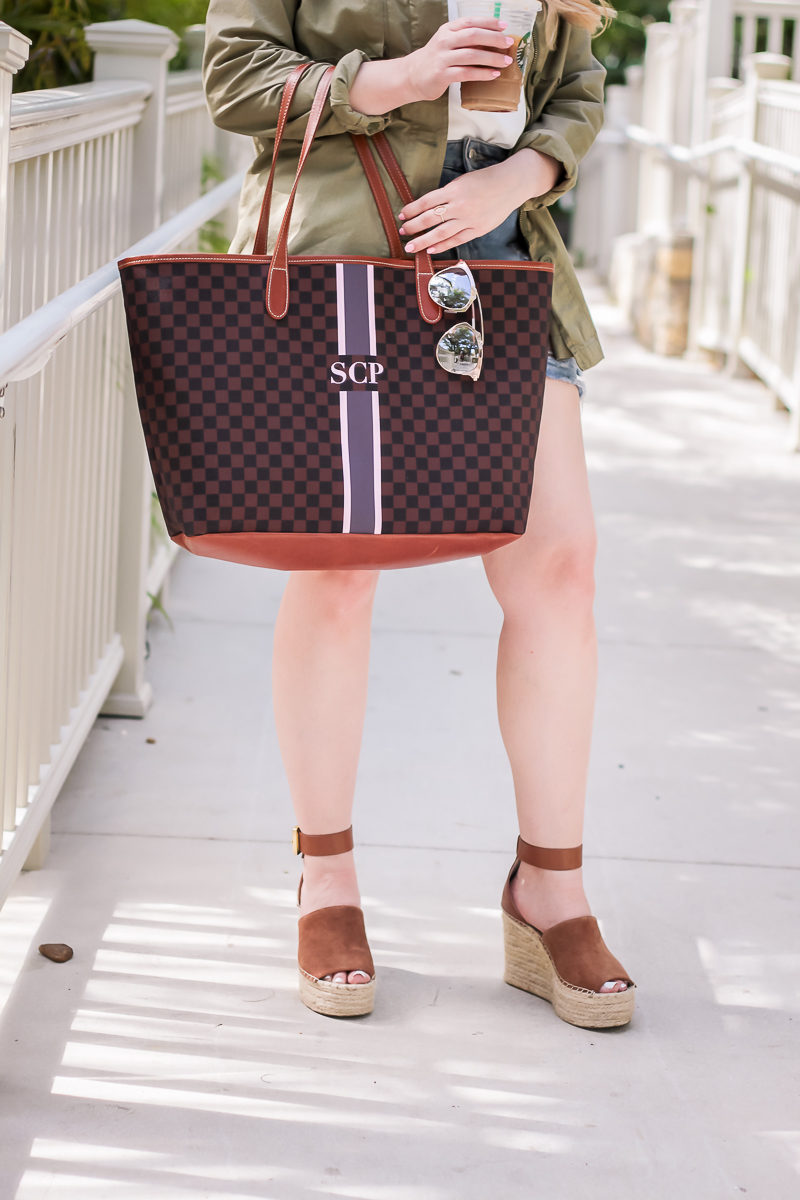 Miami fashion blogger Stephanie styles Marc Fisher Adalyn wedges with Topshop jean shorts and a Barrington gifts tote