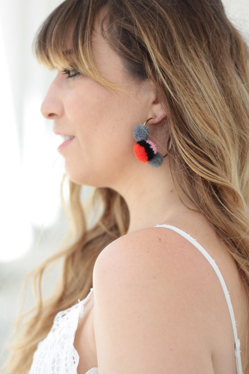 Miami fashion blogger Stephanie Pernas wearing Baublebar pompom earrings