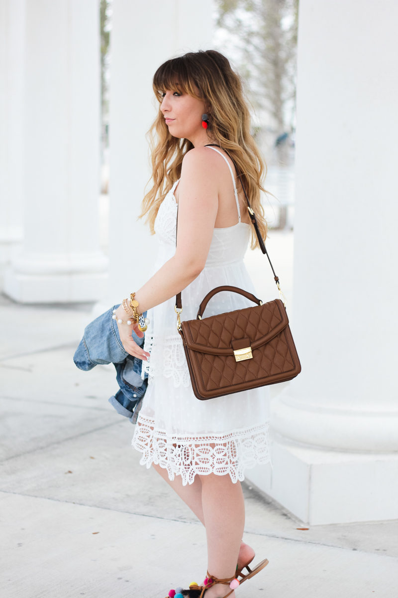 Miami fashion blogger Stephanie Pernas styles the Vera Bradley Lydia satchel with a white lace dress