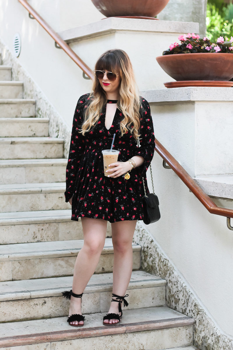 Miami fashion blogger Stephanie Pernas wearing a boho floral dress and fringe sandals