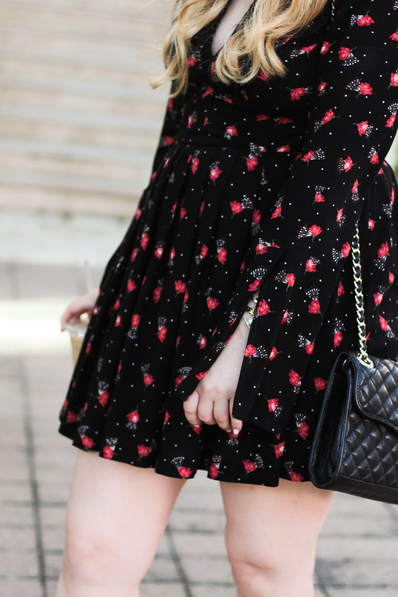 Miami fashion blogger Stephanie Pernas styling a floral Free People dress