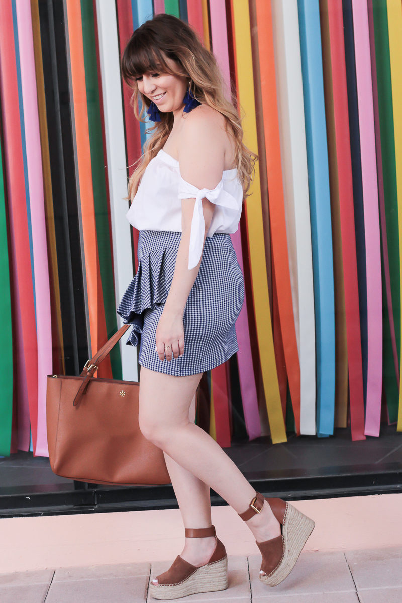 Miami fashion blogger Stephanie Pernas wearing a cold shoulder top and mini skirt for spring