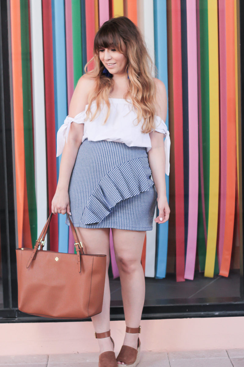 Miami fashion blogger Stephanie Pernas styles a Topshop gingham skirt and off the shoulder top