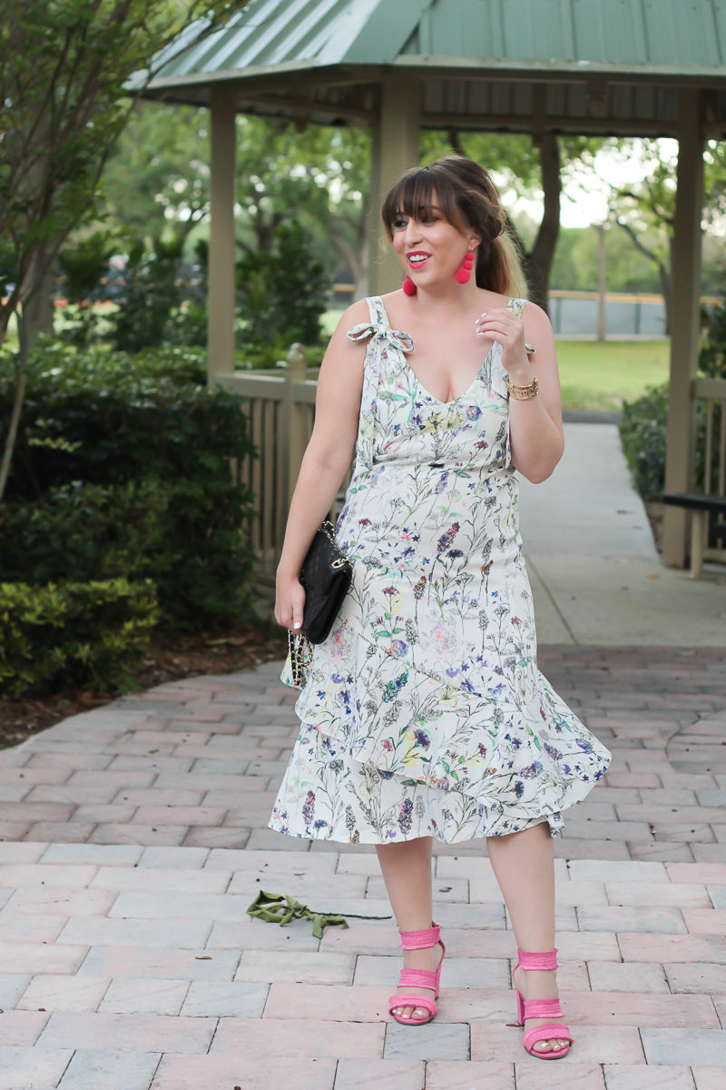 Miami fashion blogger Stephanie Pernas wearing hot pink sandals and a floral midi dress