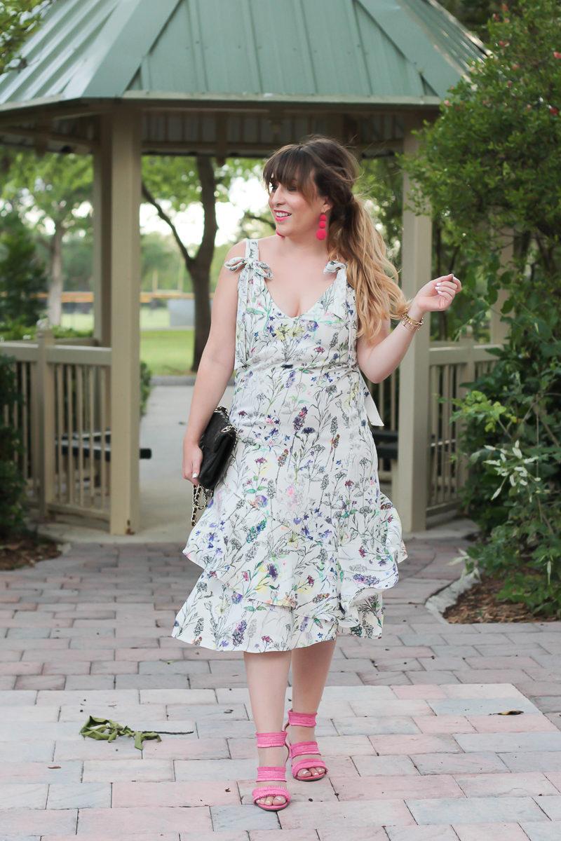 Miami fashion blogger Stephanie Pernas wearing an H&M floral midi dress