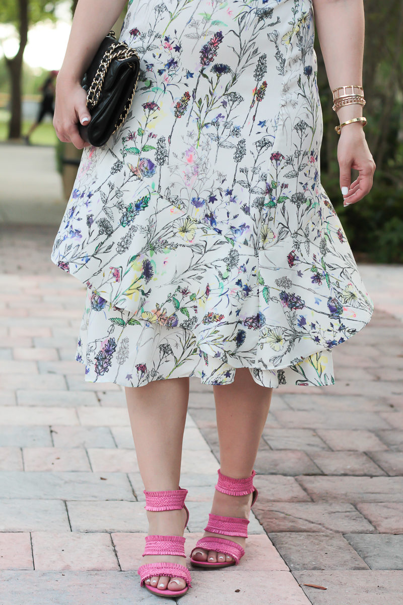 Miami fashion blogger Stephanie Pernas styles a floral midi dress with pink sandals