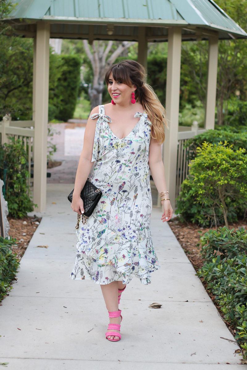 Miami fashion blogger Stephanie Pernas wearing an H&M floral dress