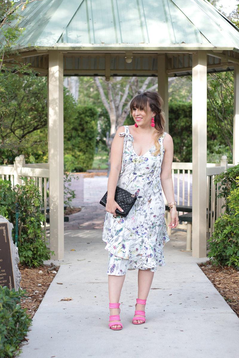 Miami fashion blogger Stephanie Pernas wearing a floral midi dress for spring