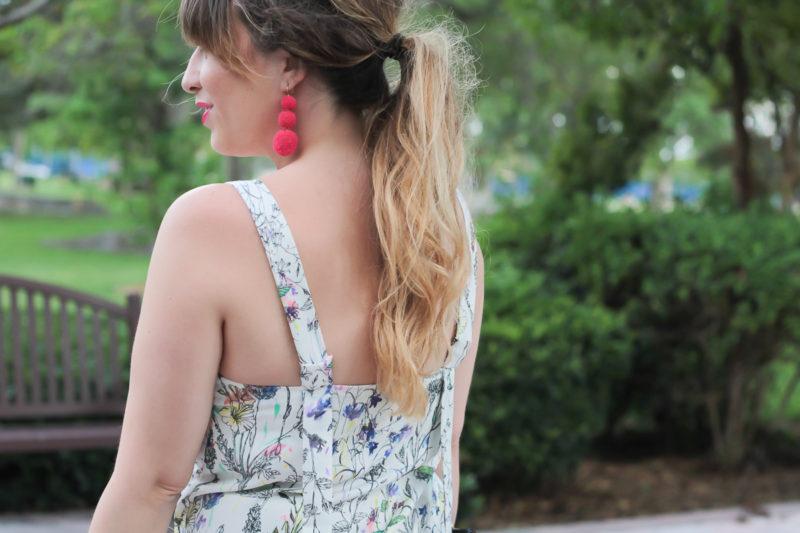 Miami fashion blogger Stephanie Pernas styles a bow shoulder midi dress with Baublebar pom pom earrings
