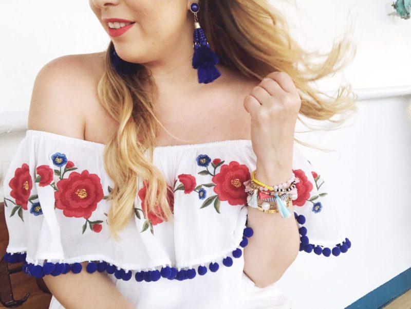 Miami fashion blogger Stephanie Pernas wearing an off the shoulder pom pom dress