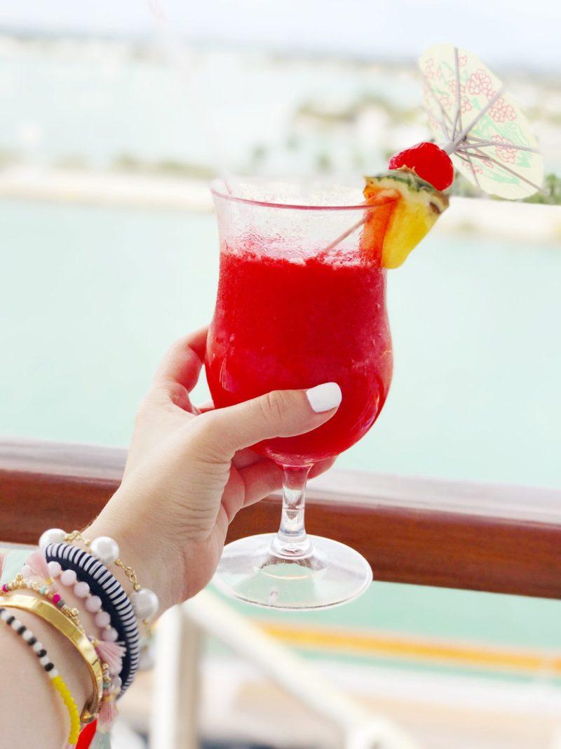 Miami fashion blogger Stephanie Pernas sips a strawberry daiquri on the Carnival Victory