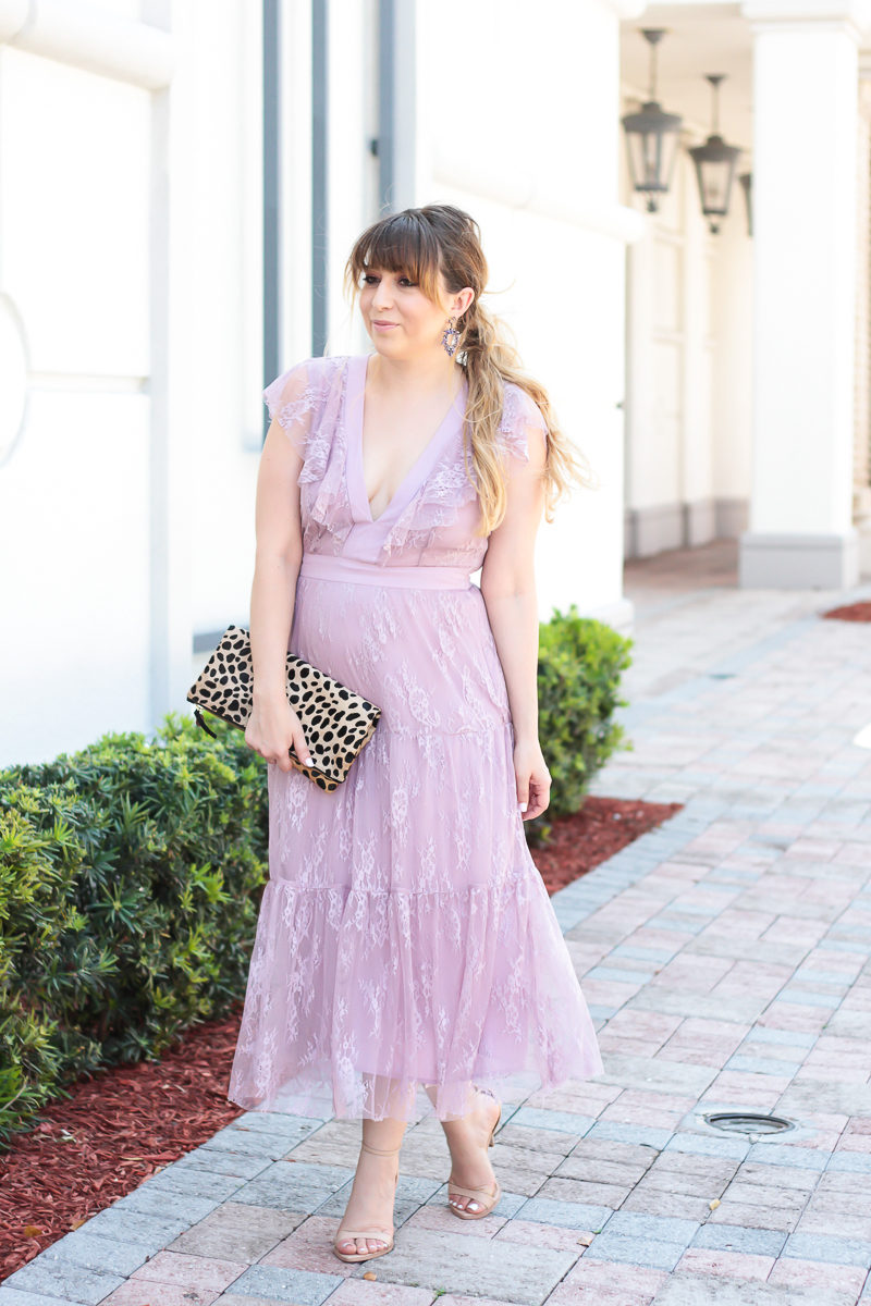 Miami fashion blogger Stephanie Pernas wearing a Wayf lace midi dress
