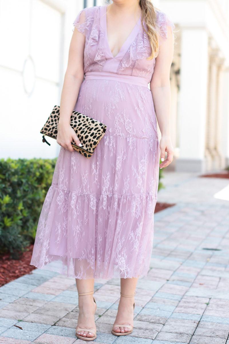 Miami fashion blogger Stephanie Pernas wearing a lilac lace midi dress