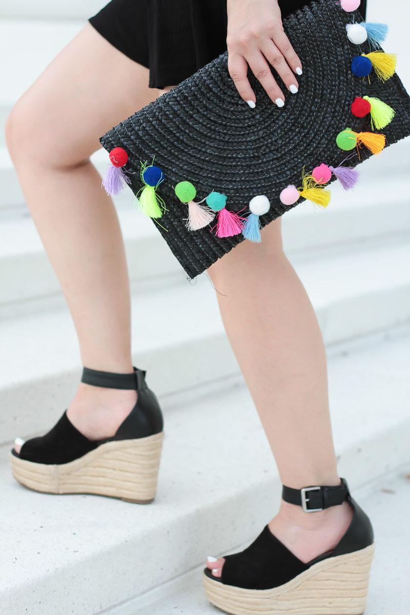 Miami fashion blogger Stephanie Pernas styles a T & J Designs straw pom pom clutch and Chloe wedge dupes