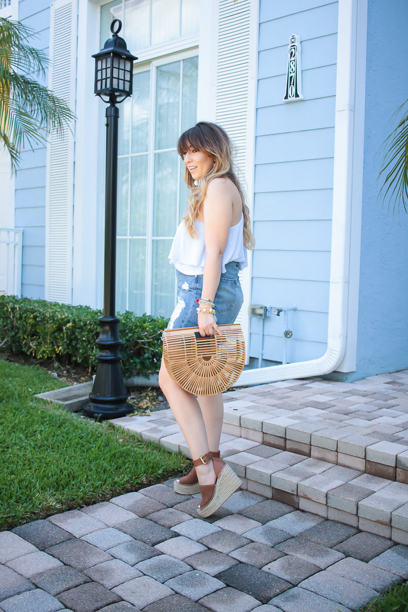 Miami fashion blogger Stephanie Pernas wearing a one shoulder top and statement earrings for spring