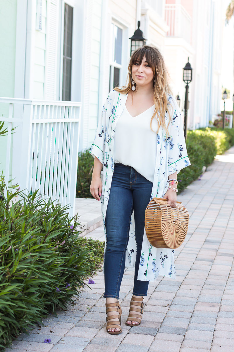 Affordable style blogger Stephanie Pernas wearing a casual kimono and jeans outfit