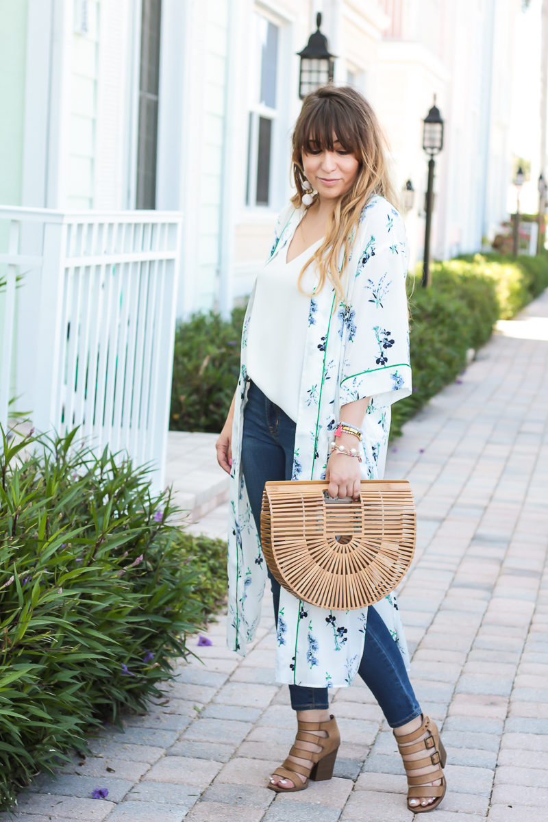 Miami fashion blogger Stephanie Pernas styles a Cult Gaia bag with a kimono and jeans for a casual spring outfit idea