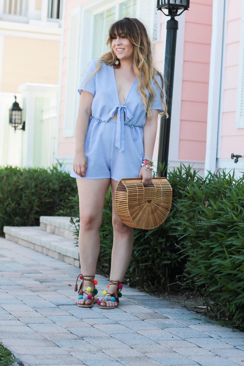 Miami fashion blogger Stephanie Pernas wearing a blue stripe romper for spring