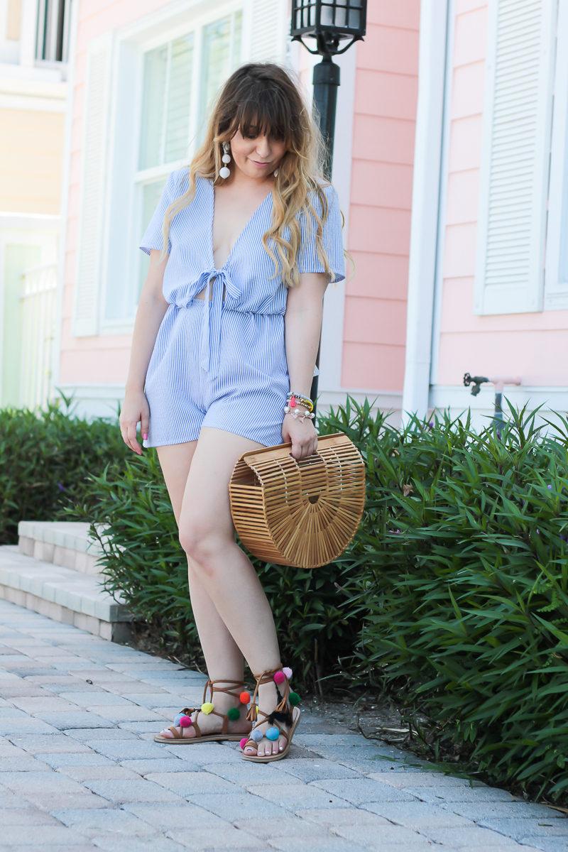Miami fashion blogger Stephanie Pernas wearing a stripe tie romper and pom pom sandals