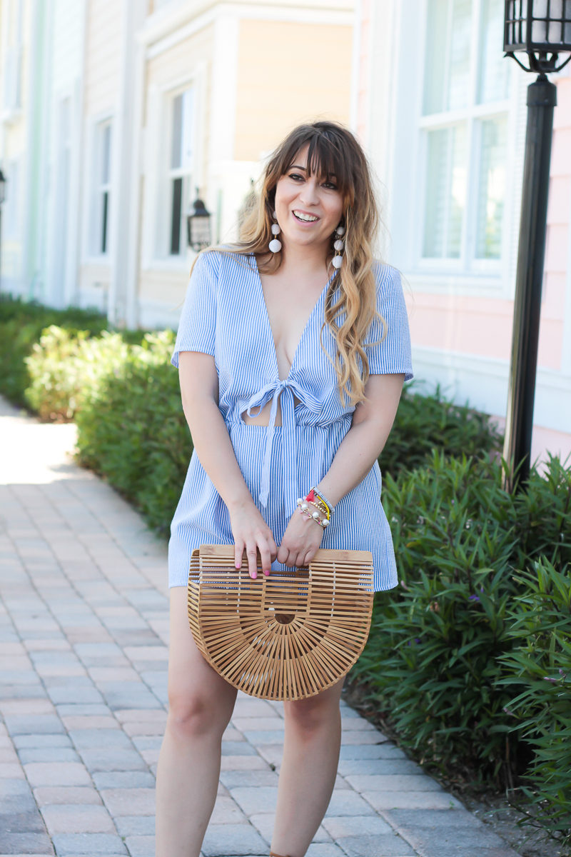 Miami fashion blogger Stephanie Pernas wearing a Missguided stripe tie front romper and Cult Gaia Gaia's Ark bag