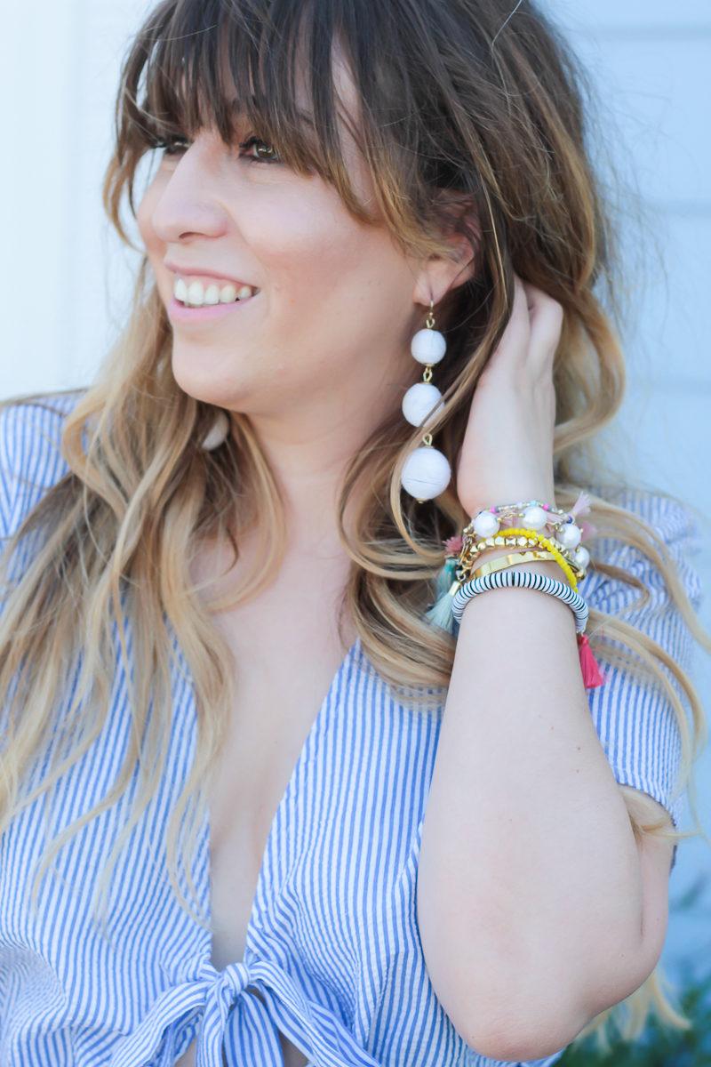 Miami fashion blogger Stephanie Pernas wearing Charming Charlie Austin earrings, similar to the Baublebar Crispin Drops