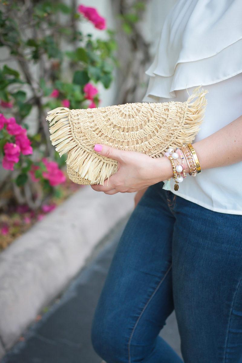 Miami fashion blogger Stephanie Pernas styles a Mar y Sol Mia clutch and a girly bracelet stack