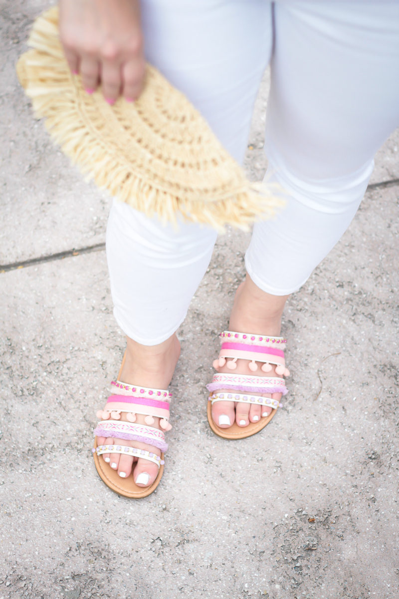 Miami fashion blogger Stephanie Pernas wearing pink pom pom sandals and white skinny jeans