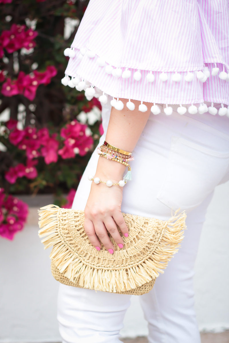 Miami fashion blogger Stephanie Pernas styles a pink pom pom top and Mar y Sol Mia clutch