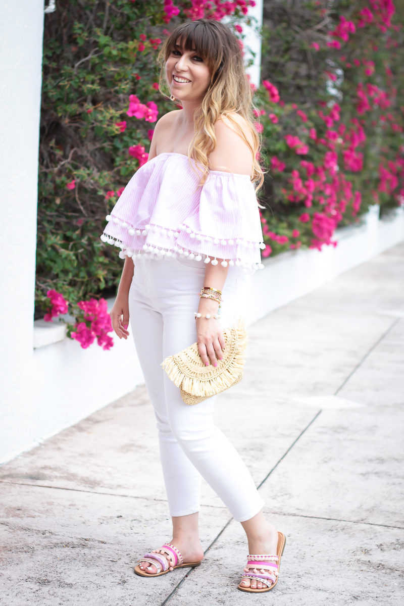 South Florida fashion blogger Stephanie Pernas wearing a pink stripe crop top and white jeans
