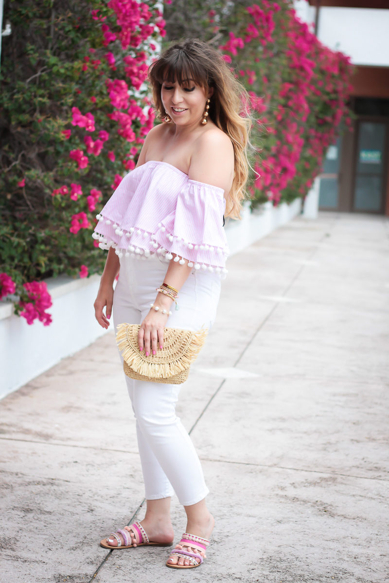South florida fashion blogger Stephanie Pernas styles an off the shoulder pom pom top and white jeans for spring