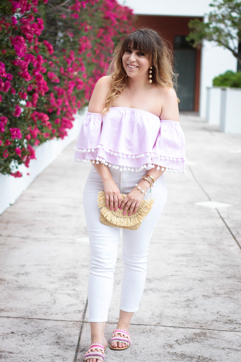 Miami fashion blogger Stephanie Pernas wearing a stripe pom pom crop top and white skinny jeans