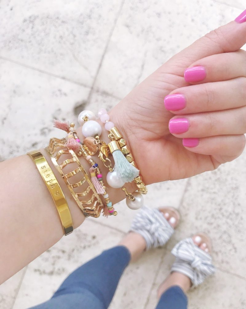 Miami fashion blogger Stephanie Pernas shares a photo of her pink manicure and bracelet arm party