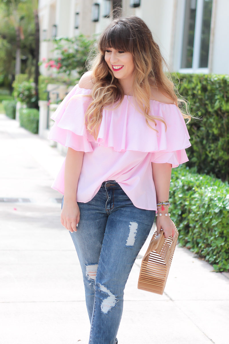 Miami fashion blogger Stephanie Pernas styles a cute pink gingham top and jeans outfit idea