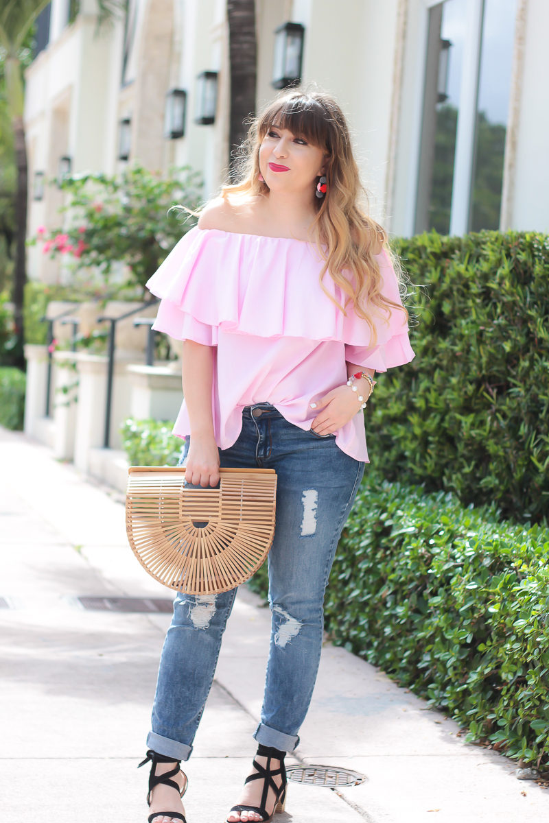 Miami fashion blogger Stephanie Pernas styles an off the shoulder top and jeans outfit