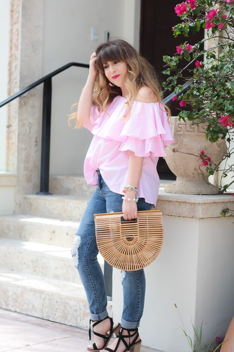 Miami fashion blogger Stephanie Pernas wearing a pink gingham top and jeans for a cute summer outfit
