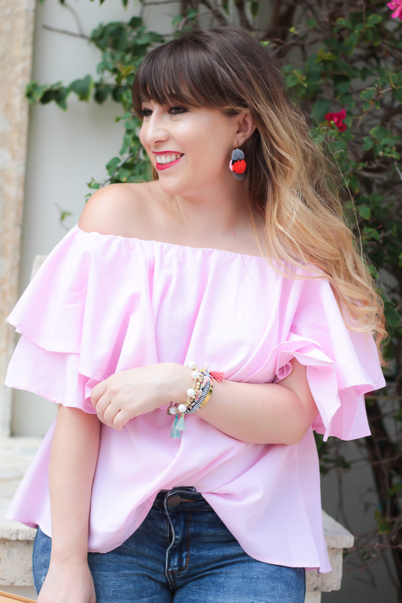 Miami fashion blogger Stephanie Pernas wearing an off the shoulder top and Baublebar pom pom hoop earrings
