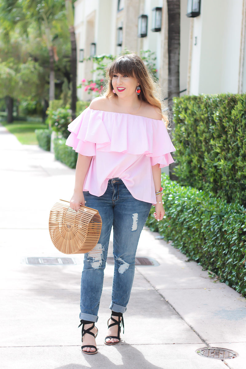 Miami fashion blogger Stephanie Pernas wearing a pink gingham off the shoulder top and jeans