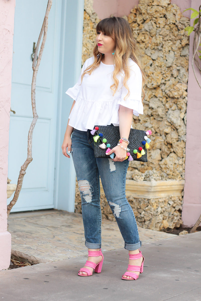 Miami fashion blogger Stephanie Pernas wearing a ruffle top and jeans outfit