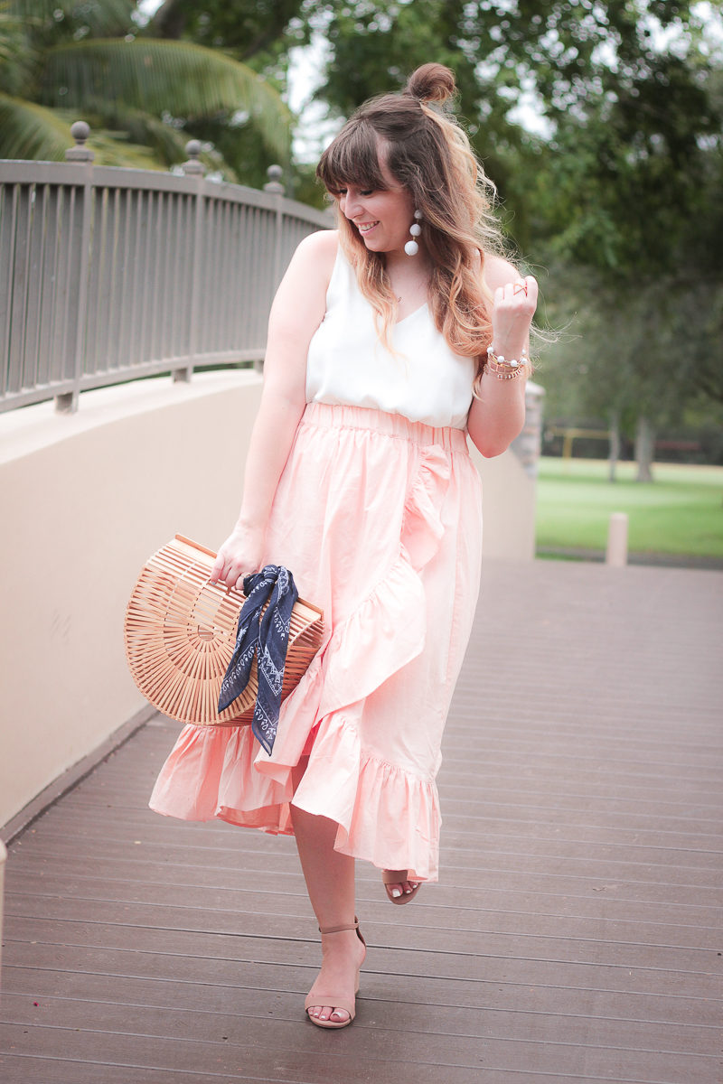 Fashion blogger Stephanie Pernas wearing an ASOS wrap midi skirt and cami with block heels for summer