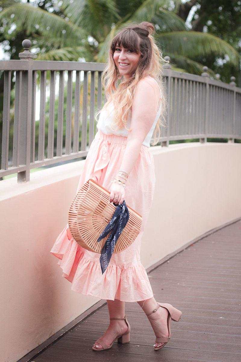 Miami fashion blogger Stephanie Pernas wearing a cute midi skirt outift idea