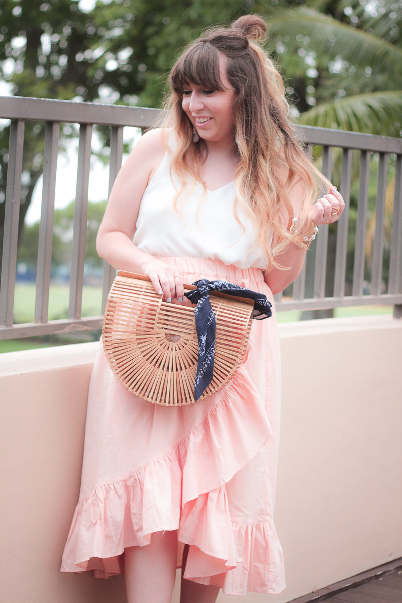 Miami fashion blogger Stephanie Pernas wearing a pink ruffle layered skirt for summer