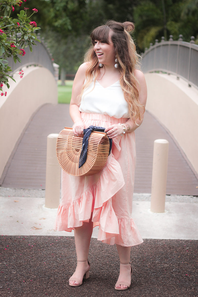 Miami fashion blogger Stephanie Pernas wearing an ASOS pink ruffle midi skirt