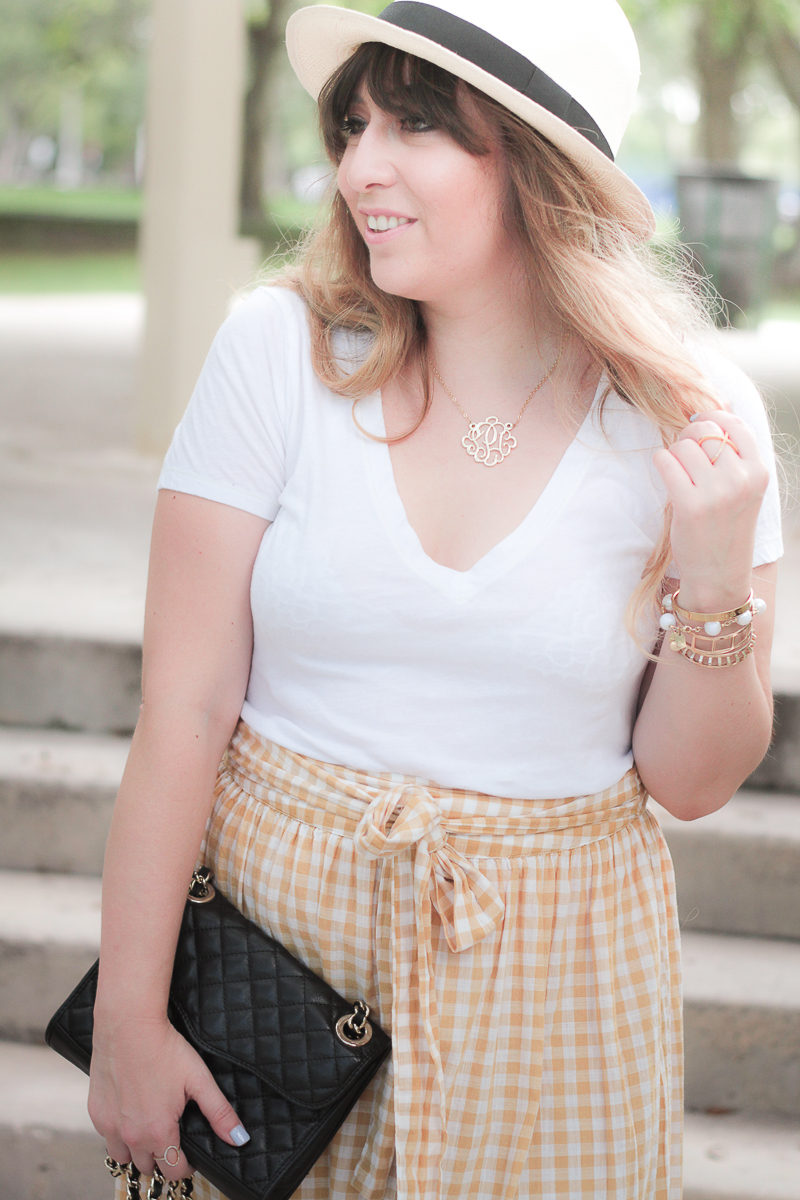 Miami fashion blogger Stephanie Pernas wearing a J.Crew Panama hat and ruffle gingham skirt