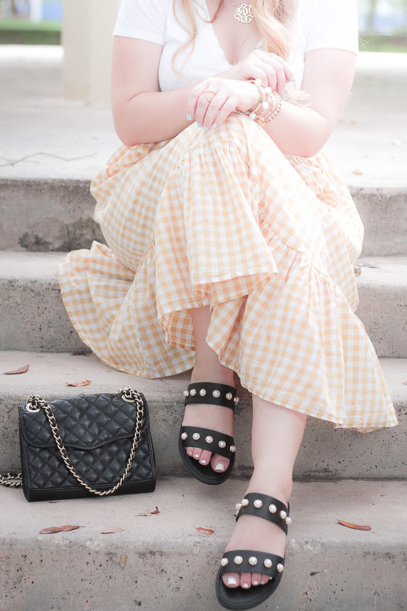 Miami fashion blogger Stephanie Pernas wearing a gingham skirt and pearl slide sandals