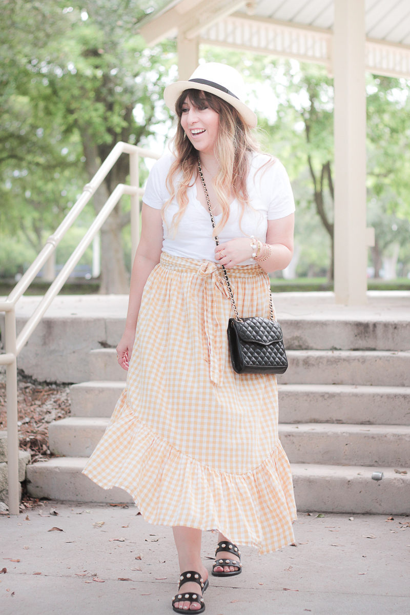 Miami fashion blogger Stephanie Pernas styles a ruffle maxi skirt casual summer outfit idea